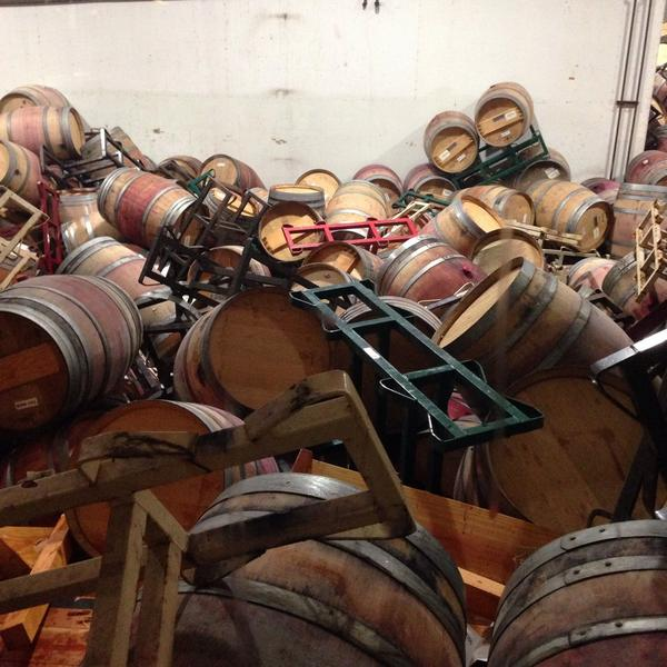 photo with wine barrels destroyed by California earthquake